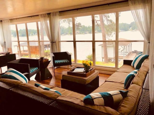 The panoramic glass windows provide a sweeping view of the lake while you cuddle up with a book or two.