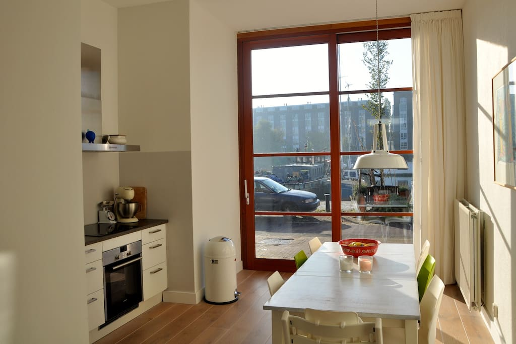The kitchen is very light and situated at the waterfront. From the kitchen you have a beautiful view at the harbour.