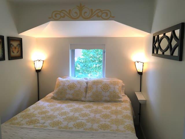 Queen sized bed in quiet cozy bedroom