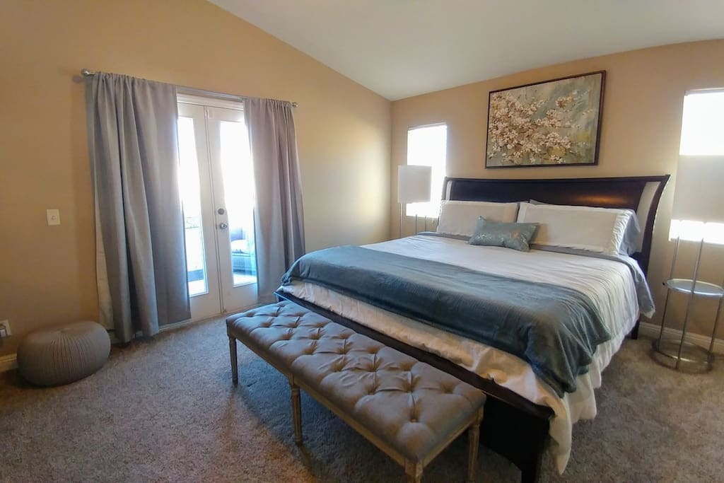 Beautiful, spacious master suite with elegant King bed. French doors open to your own furnished balcony.