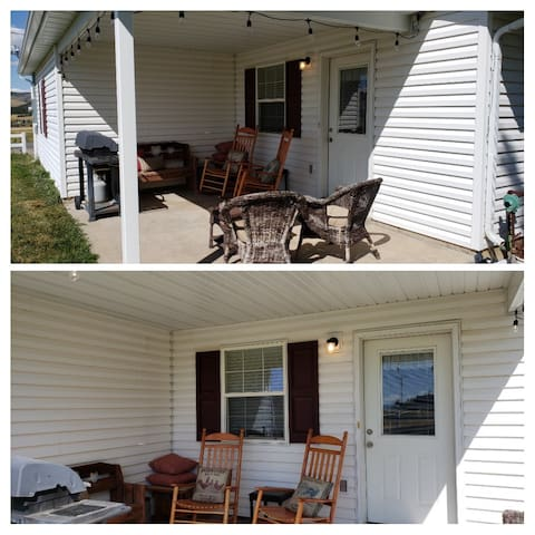 Back porch sittin'. Plenty of room for the whole family to BBQ, visit and relax.