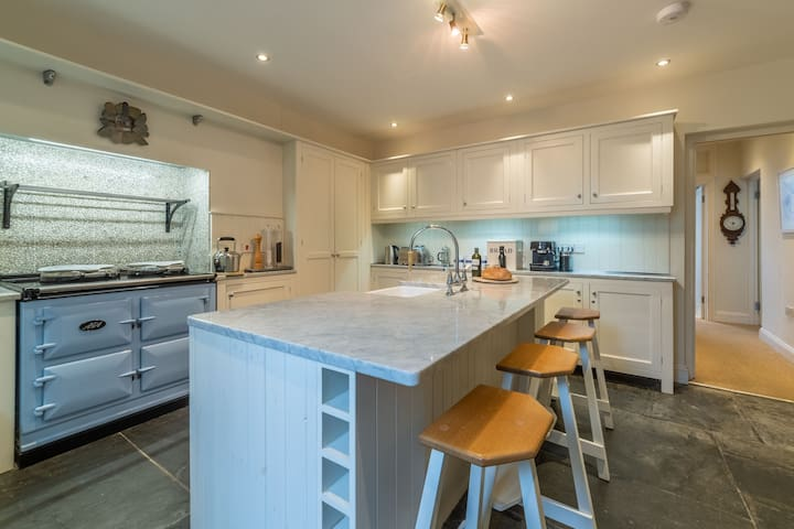Ground floor:  Kitchen with breakfast bar and AGA