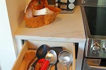 Spices, dinner napkins, cooking utensils.
