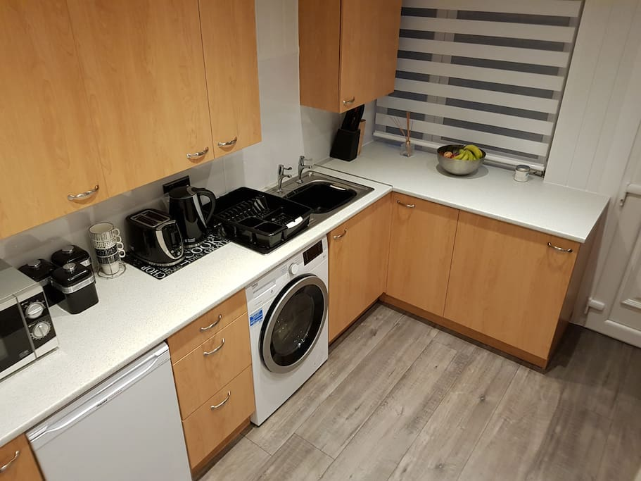Kitchen space with access to kettle, washing/dryer , microwave , cooker , iron and iron board