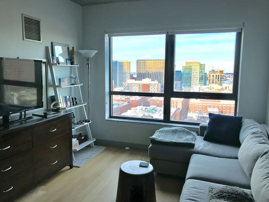 Living room overlooking downtown Boston and the harbor