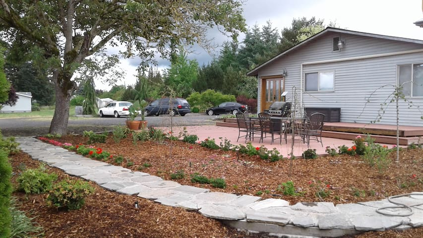 Your private deck and private entry way (deck newly installed late spring 2017; plantings are now more mature).  Yes that grill is there for your use as well!