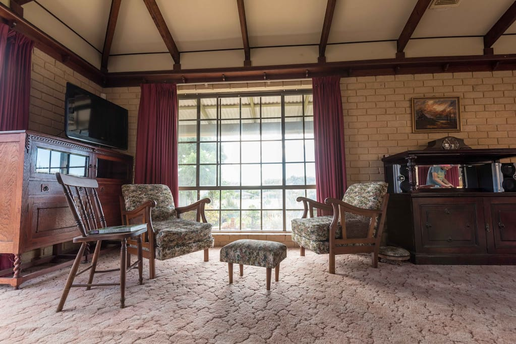 Large living space with couches and single seats. Many a deep conversation has occurred here
