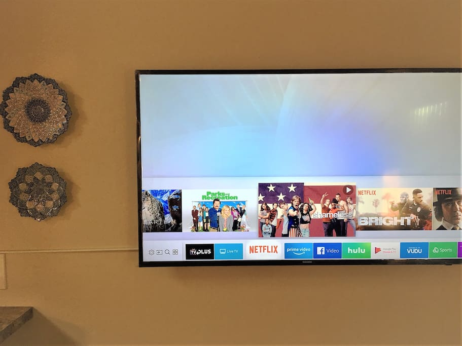 Samsung 49'' TV for you to browse and watch. Netflix is set!