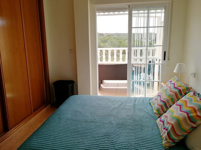 Main bedroom with air conditioning  and  Ensuite.  Freshly decorated with king size bed, patio doors leading to balcony with patio seating. Views to nature reserve. Bed linen and towels supplied including duvet for cooler months.
