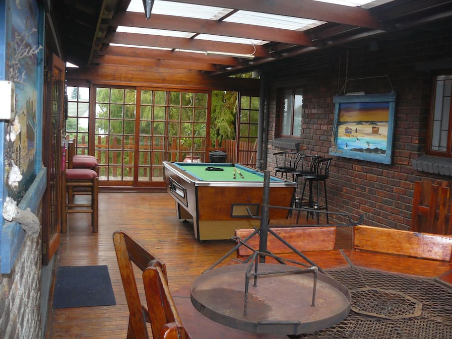 Braai/BBQ area for cottage 3 with its beautiful braai table. In the back ground is the communal pool table