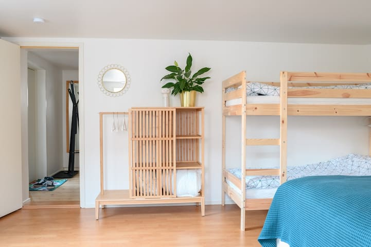 Bedroom with double bed, bunk bed and reading corner
