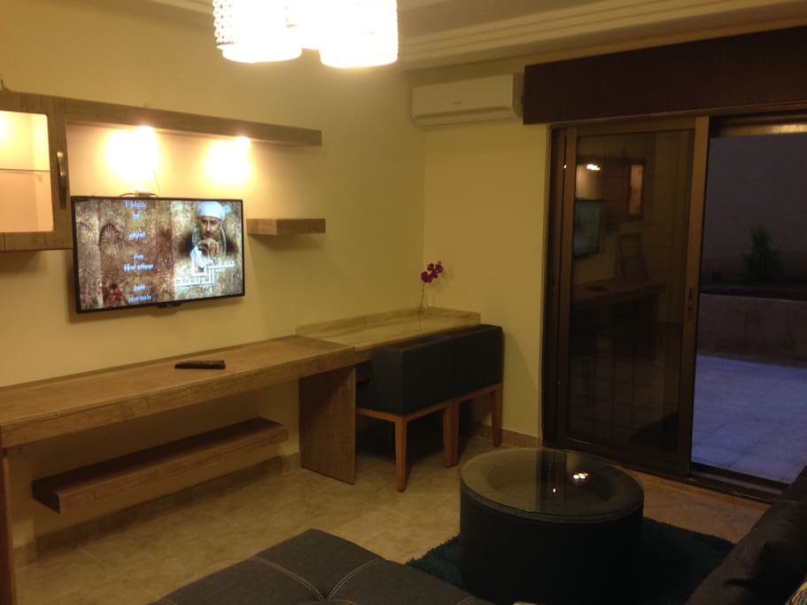 The royal luxury queen terrace 1 apartments for rent in for Living room with 65 inch tv