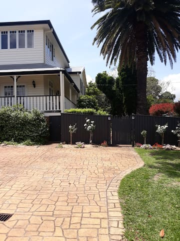 Parking space facing house enter through gate between roses. Flat under main house.