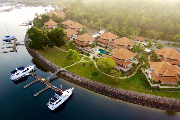 Bird's-eye view of the Classic 1 apartments with owners' boats berthed at private pontoons.