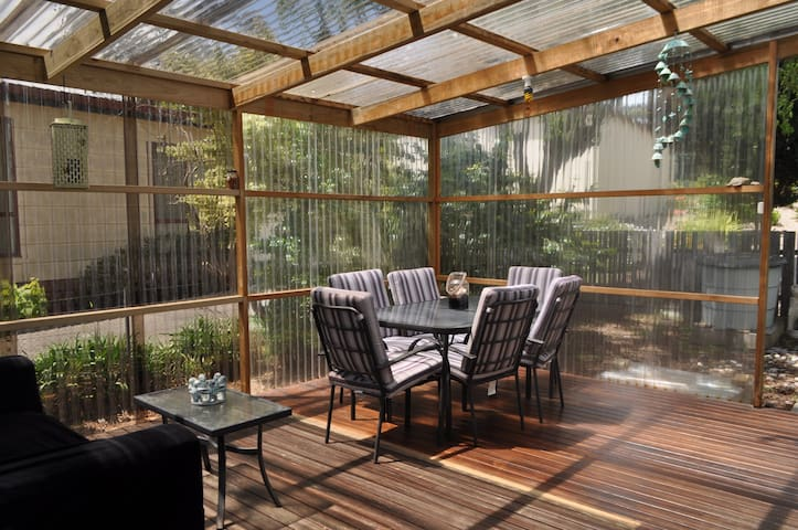 Warm and large sunny deck protecting you from the wind and rain in winter.