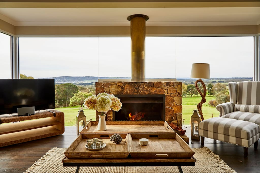 The huge stone fireplace and luxury furnishings in the cottage with views to die for.