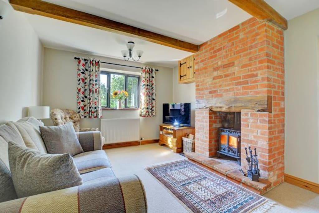 Cosy lounge with log burner  and large freeview TV / selection of DVDs to enjoy those evenings in