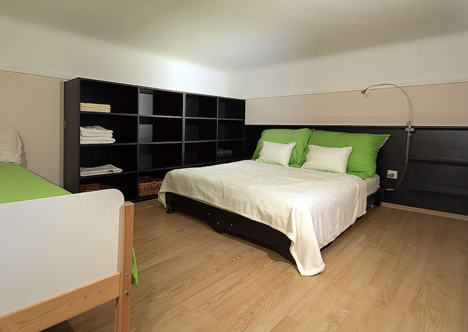A Double bed and also a Single bed located upstairs. Also a lot of storage space is available.