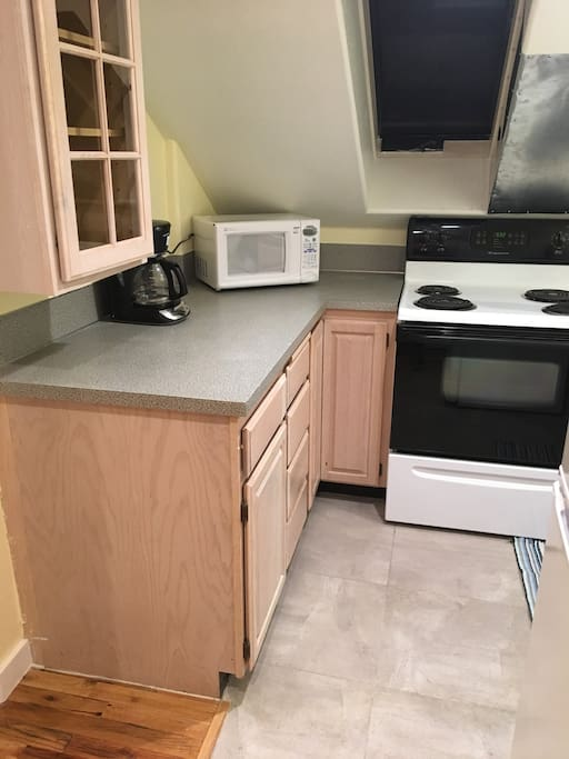 A sweet Kitchenette with everything you need! Coffee maker, microwave, dishes, pots and pans, and coffee, creamer, bagels and cream cheese!