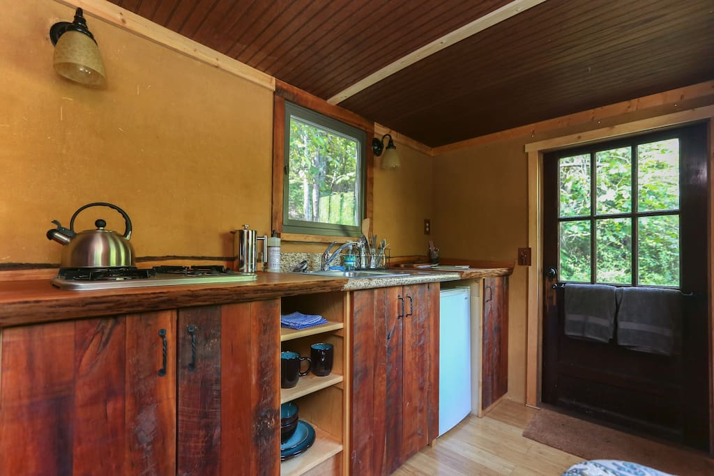 The box truck has a 3 burner stove, a sink, a mini-fridge, and plenty of cherry wood and granite counter space.