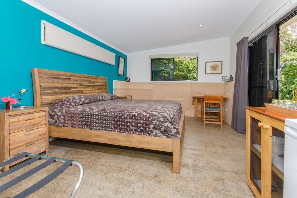 Spacious bedroom tastefully appointed, including a king-size bed