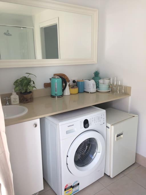 Small fridge, washing machine, kettle, coffee machine and toaster