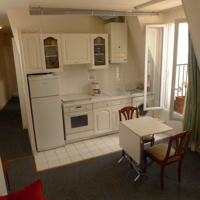 Kitchen is equipped with a full-sized fridge, gas range, dishwasher, washing machine, and all utensils and cookware.