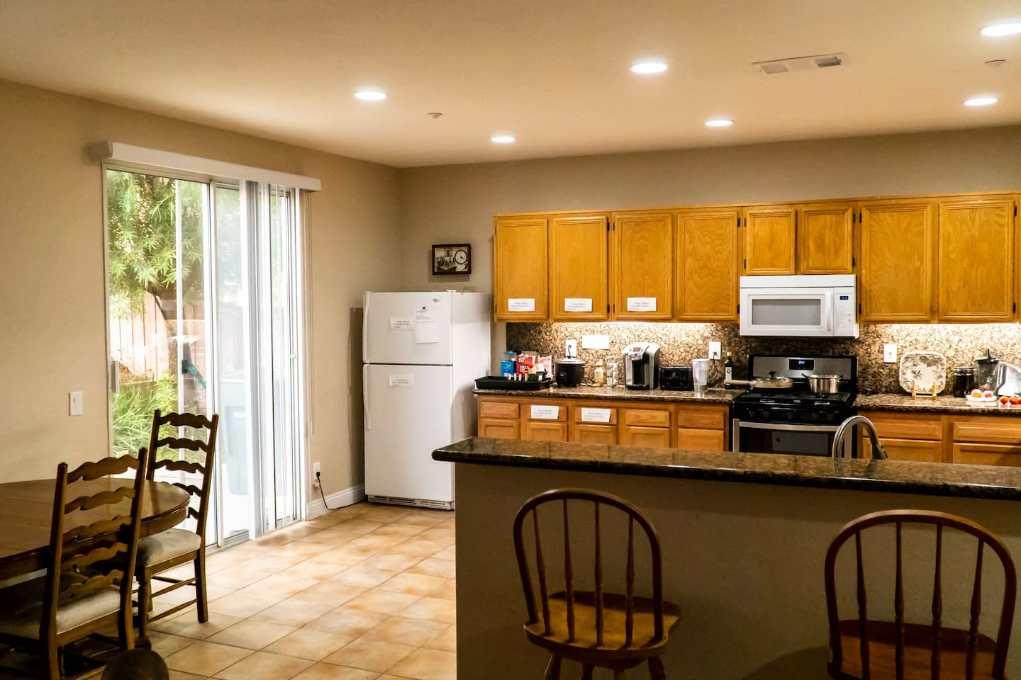 Beautiful spacious kitchen with fridge, microwave, Keurig coffee maker, silverware, and lots of cabinet space.