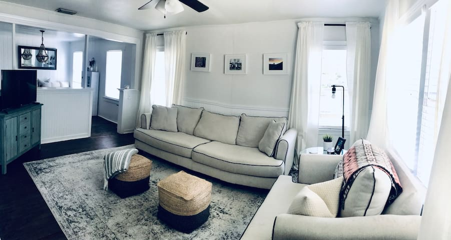 Sofa and overstuffed chair in the living room along with smart TV with ROKU (Netflix, Hulu, Amazon, etc.)