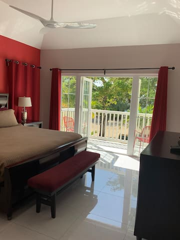 Last but definitely not least, the Master Bedroom! The room is furnished with a true King bed, a 58 inch flat screen, a larger A/C unit, a ceiling fan, blackout curtains, walk-in closet, a vanity table & a balcony that overlooks the beach and ocean!