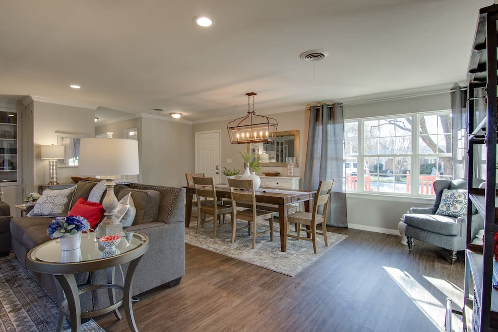 Huge Windows with Open Floorplan.  Farmhouse table for 8