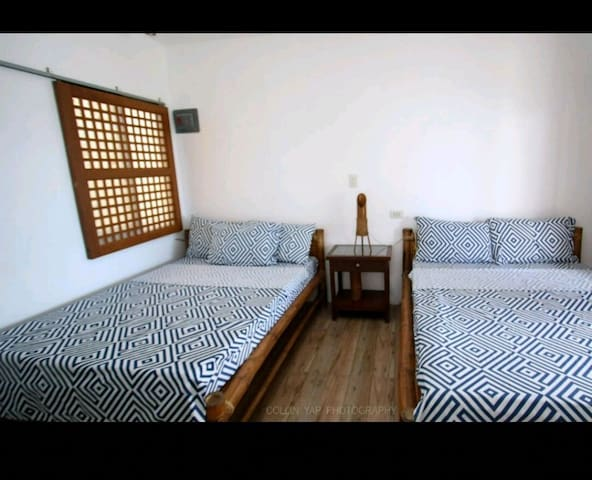 Two queen size bed plus two single floor mattress bed