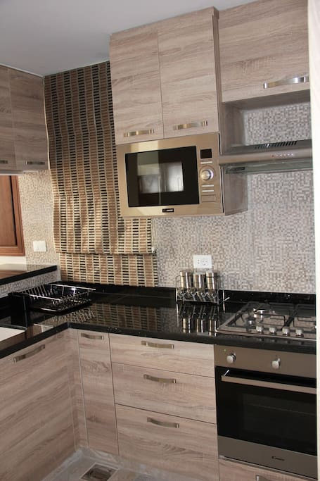 A fully equipped American style open- kitchen