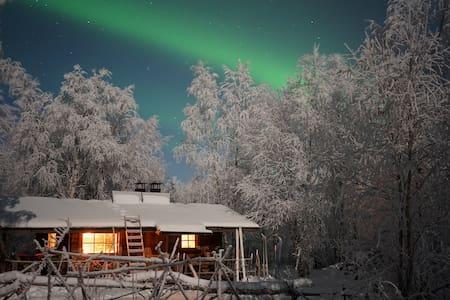 Riverland wilderness cabin with sauna in Lapland