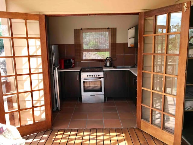 Fully equipped kitchen, open plan. Opens onto the porch