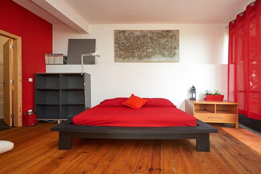 Double bedroom on raised platform