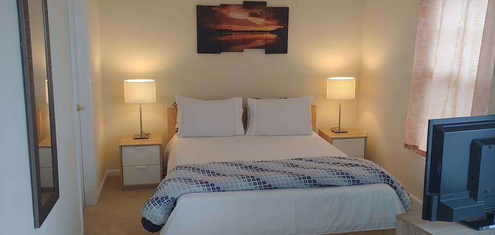 Southern comfort.    Lovely bedroom in Beach home