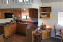 Fully equipped kitchen.  Includes dinnerware, cookware, utensils, toaster, blender and coffee maker