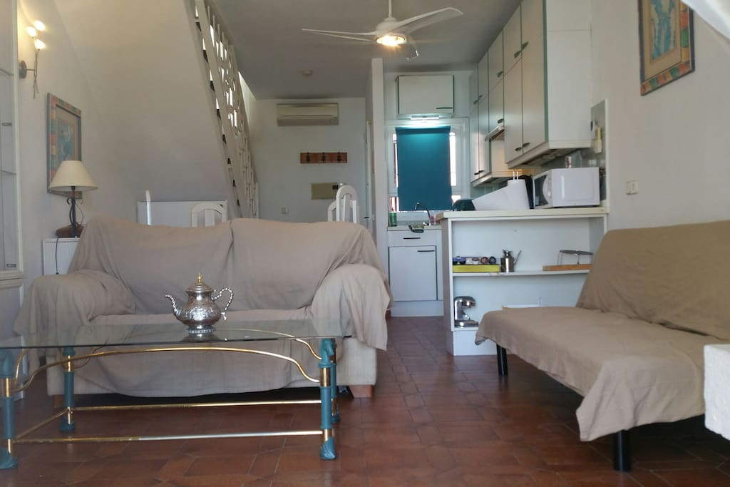 First floor: Full-service kitchen, indoor dinner table, couch, futon