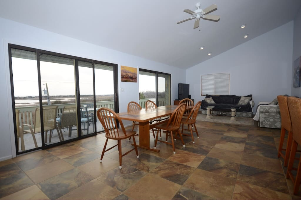 View of dining room, living room, and large balcony.