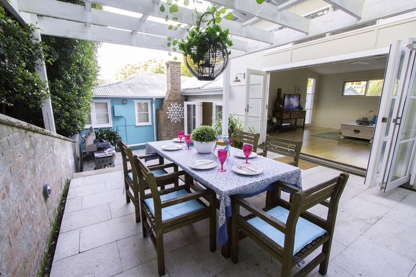 Enjoy the lovely courtyard and alfresco dining.