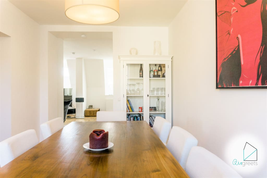 The dining room offers you a big table to enjoy your homecooked meal.