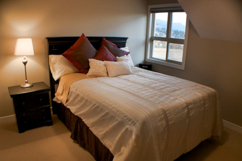 Master Bedroom with walk in closet, ensuite and view directly onto Lake Windermere and the moantains.