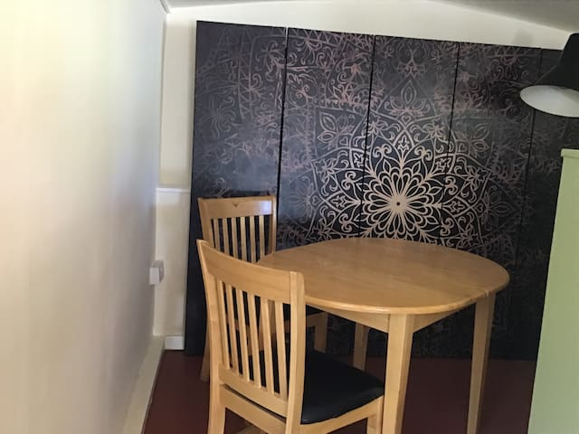 Area in open plan . Table and 2 chairs