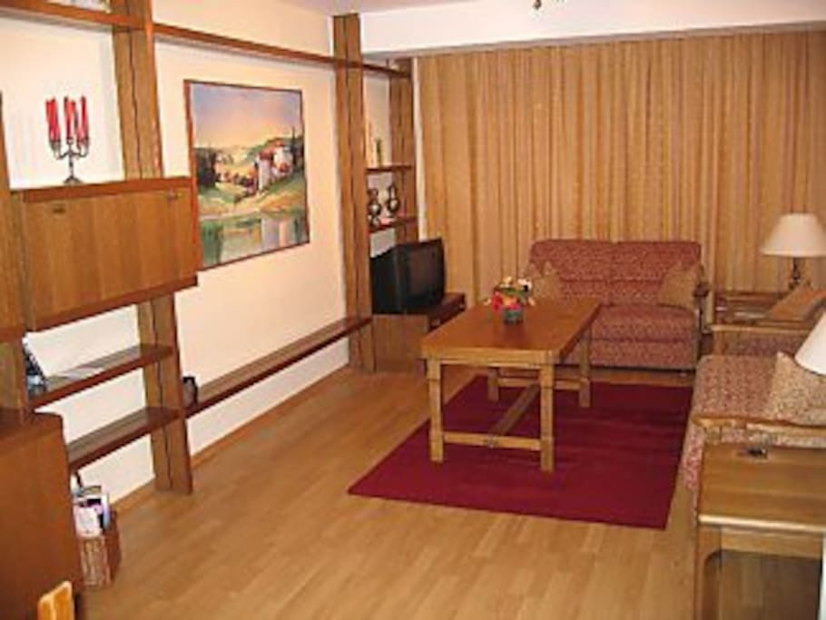 Lounge area including settee which converts to a double bed.