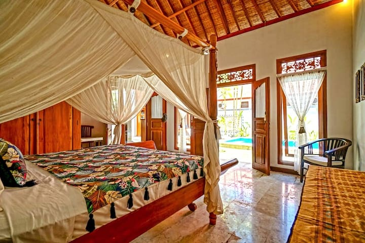 Master bedroom with ensuite. King size bed. Pool view 2 bedroom private villa. 4 guests. Minutes walk to the beach. Fully serviced.