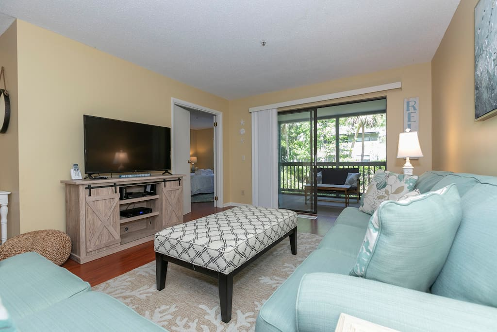 Spacious seating with access to private screened in patio