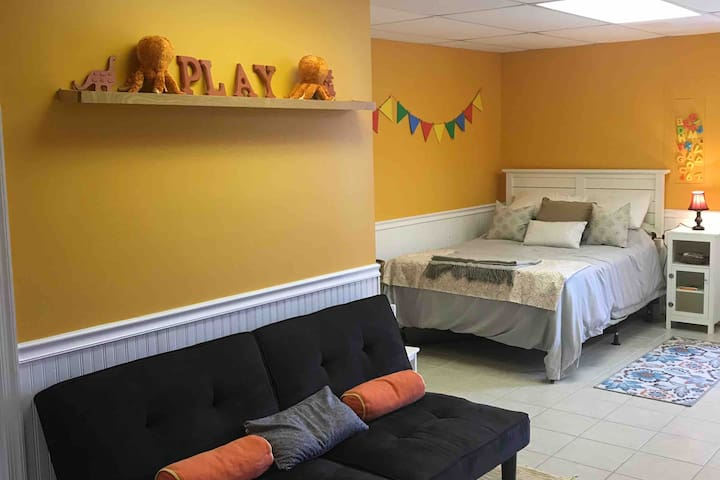 Family friendly basement playroom with full  bed, play area, futon couch (sleeps 1) and private half bath. This space is a bonus/4th bedroom with closet and 1/2 bath. It is not counted as one of the 3 bedrooms in the listing. It is a bonus bedroom.