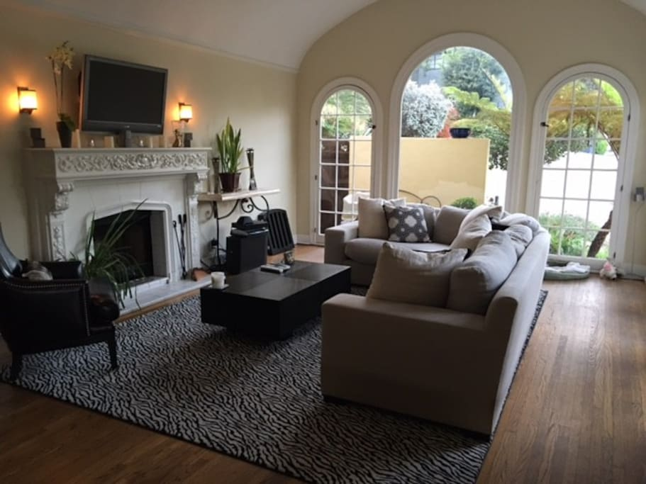 Spacious Living room with high barrel ceilings, bright and cheerful arch windows