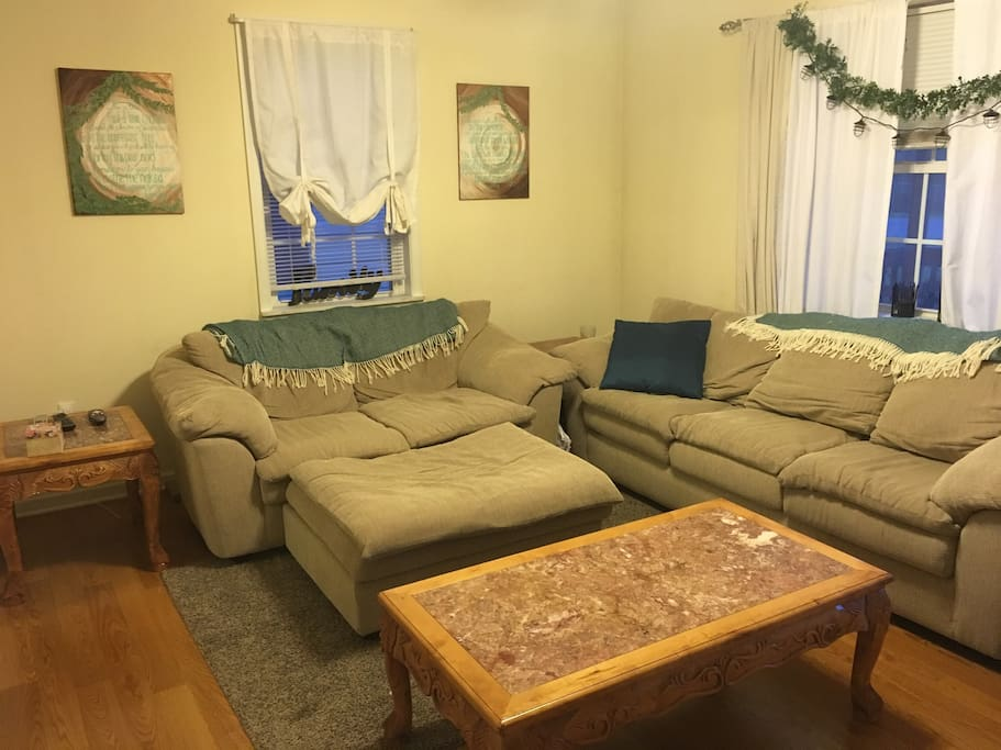 Cozy living room with full sizes sofa and love seat with ottoman
